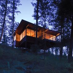This gorgeous and cozy cabin retreat on Flathead Lake is located in Polson, Montana and designed by Andersson Wise Architects. Flathead Lake Montana, Cabana, Butterfly Roof, Cabin In The Woods, House On Stilts, Wooden Cabins, Lake Cabins, Cozy Cabin, Sweet Home
