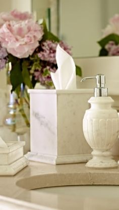 A study in Classical design, our exclusive Dauphine Countertop Collection features the clean elegance of crisp white marble and richly carved plinths.