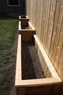 12 Raised Garden Bed Tutorials raised vegetable garden against fence? Exactly what I want. Now to convince hubbyor a son in law! The post 12 Raised Garden Bed Tutorials appeared first on Garten. Garden Types, Diy Garden, Garden Projects, Fence Garden, Sloped Garden, Fence Plants, Diy Fence, Cool Garden Ideas, Garden Pots
