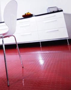 Flooring Fixes Red Rubber Flooring Fixes in the Kitchen with White Cabinets and Chair