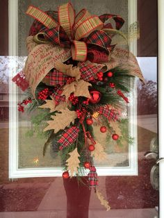 40 rustic christmas decor ideas you can build yourself for the rustic burlap poinsettia and glittered leaves adorn this gorgeous custom christmas swag solutioingenieria Choice Image