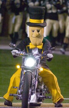 Wake Forest University's mascot, the Demon Deacon, riding his motorcycle into Groves Stadium before each home game. Wake Forest University, College Football Teams, Football And Basketball, Sports Teams, Wake Forest Football, Wake Forest Demon Deacons, Sports Advertising, Team Mascots, Black Sharpie