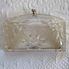 vintage lucite clutch with rhinestones.  I have this same purse.