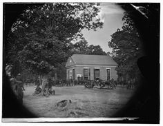 View of Massaponax Church in Virginia, temporary headquarters of Gen Ulysses S. Grant, surrounded by soldiers, photographed by Timothy O'Sullivan, May 1864