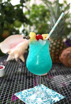 Make a blue Hawaii cocktail with coconut rum, blue curacao, and pineapple juice for an end-of-summer luau.