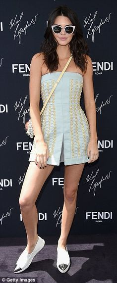 Accessorizing: She wore a detailed yellow Fendi bag over her shoulder which had pieces of ...