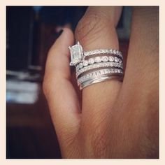 WOW. LOVE this mix. Engagement ring, simple wedding band, and one band for each child.