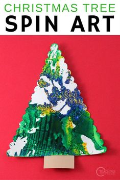 These easy spin art trees are a fun Christmas art activity for toddlers and preschoolers. Grab your salad spinner, some paint, and some glitter! #christmas #art #christmastree #processart #toddler #preschooler #AGE2 #AGE3 #AGE4 #artsandcrafts #holiday