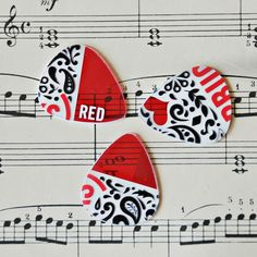 Upcycled guitar pick made out of plastic gift cards.