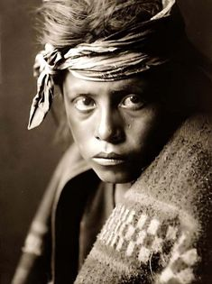 "Here for your enjoyment is an inspiring photograph entitled ""Youth From the Desert Land"". It was made in 1906 by Edward S. Curtis.    The photo shows a young Navajo boy, wrapped in a blanket, and with a bandana on his head. There is a look of sadness in the boy's eye, perhaps reflecting the difficlut position these original Americans faced at the turn of the century.."