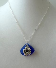 Cobalt Blue Sea Glass Pendant with Hibiscus Charm by cjsseashop, $30.00