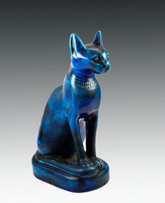 Faience Cat Ancient Egypt - 26th Dynasty  Vivid blue faience cat seated on a base and wearing a collar  Sacred animal to the sun god Ra and Bastet. The earliest Egyptian depiction of the cat took the form of three hieroglyph symbols, each representing seated cats. These formed part of the phrase 'Lord of the City of Cats' inscribed on a stone block from El-Lisht that may date as early as the reign of Pepy II, 2278-2184 BC. The Egyptian word for cat was the onomatopoeic term miw.