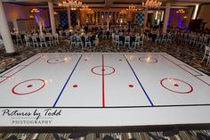 Hockey rink dance floor for a hockey themed bar mitzvah.  What a great idea!!