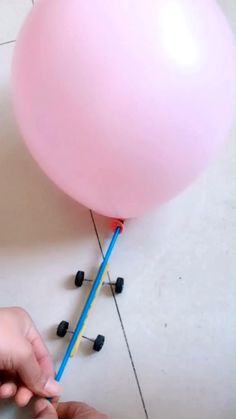 Do you think you could build a car powered by the balloon? A balloon-powered car is pushed forward by air escaping from a balloon, and it is fun and easy to build with materials you already have around your house. It is a classic science project for kids. Toddler Learning Activities, Science Activities For Kids, Science Experiments Kids, Stem Activities, Science Fair, Life Science, Balloon Powered Car, Balloon Cars, Science Projects For Kids
