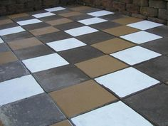 Hand Painted Pavers... You can use ANY color Exterior Paint w/Primer inc. to transforn pavers, cement, etc. Will not come off once put on.