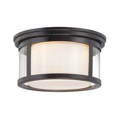 """Wilson is a unique flush mount series. The opal etched glass is surrounded by another clear glass shade for a unique look. The great design and versatile Palladian Bronze finish is sure to compliment your home decor. Dimensions:7.00"""" H x 13.00"""" W x 13.00"""" D Avaiable @ DullesElectric.com"""