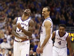 Kansas forward Perry Ellis (34) smiles as teammate Jamari Traylor, left, celebrates following Ellis' high-flying lob dunk during the second half, Saturday, Feb. 21, 2015 at Allen Fieldhouse.