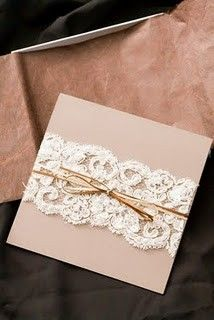 lace wrapped invites and programs.. i feel like this would be cute since it would be kind of like your dress? hahaha