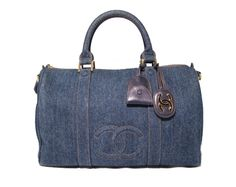 2,795.00 Chanel Denim Duffle Bag This stylish Chanel mini duffle bag is in pristine condition. The exterior features wonderful blue jean denim trimmed with gold hardware and comes complete with a 37 in removable shoulder strap.
