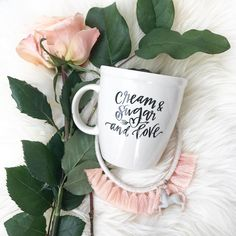Add a little sweet cream to your morning with the Cream, Sugar, and Love coffee mug from Lindsay Letters.
