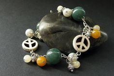 Hippie Bracelet. Peace Bracelet. Peace Sign Charm Bracelet. Gemstone Bracelet with Howlite Orange Jade and Aragonite. Handmade Jewelry. by Gilliauna from Bits n Beads by Gilliauna. Find it now at http://ift.tt/2iMzbxa!