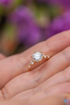 How good does this ring look with the lush greens and flowers outside our office as its backdrop? Hard not to love this classic little pop of moissanite sparkle.