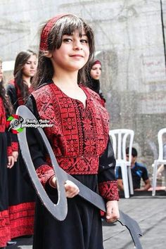 The beauty of Palestine <3  She is not a child , She is a young lady with a perfect face and a perfect mind . She is a future mother of martyers. The key of return