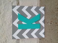 Square chevron canvas with painted letter..except with yellow instead of blue for the living room!