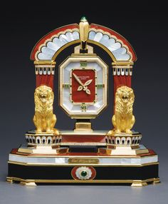 """SOLD. $700,781 - Patek Philippe """"The Ruling Lions""""  A MAGNIFICENT AND VERY RARE YELLOW GOLD, DIAMOND, EMERALD, MOTHER-OF-PEARL, ONYX AND JASPER MANTEL CLOCK MADE IN 1992"""