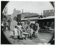 Although before it was possible to print photographs, photography was used as a research tool in developing wood-engraved illustrations. The ability for photography to document a moment in time allowed illustrators to capture a moment in history. Freedmen on the Canal Bank in Richmond, by Mathew Brady, seen below, is an example of illustration involving photography.
