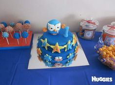 Giggle and Hoot theme. Use blue and orange theme for the food as well as decorations.