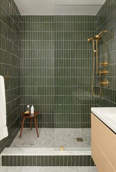 Striking just the right balance of organic and urbane, this Brooklyn bathroom's Hunter Green Tile is a lesson in bold simplicity.