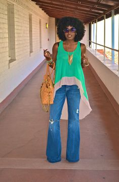 high low tank and bell bottom jeans... yes there is nothing chicer!