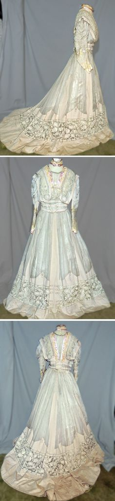 Day dress, Perdoux & Cie, Paris, ca. 1890s. Dove gray wool, sheer silk, & wide bands of embroidered netting. Trimmed with lavender-embroidered silk ribbon. Bodice is has ivory lace around collar and along edge of the lavender silk. Top of collar & yoke have bands of narrow metallic gold braid. Sleeves are ruched and embroidered in pastel floral trim below elbows. Ivory lace peeks out from bottom ande edge is trimmed with lavender silk. Shasta's Vintage/ebay