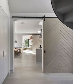 Large light grey wood barn doors have been used in this home to separate the various living and dining rooms.