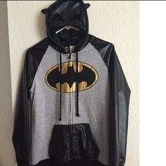 Very interesting Batman sweater ! This batman sweater comes with a mask !! How cool right ?! it's very interesting... Use to get many compliments  all that shows in black is faux leather. It marks XL but I'd say it runs small ... Will fit perfectly a L Sweaters
