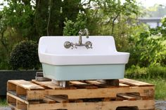 They don't make them like this anymore! Check out this Refinished Antique High Back Porcelain Farm Sinks! The large basin is perfect for use in your utility room or kitchen!