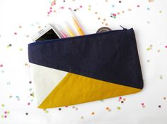 "Clutch 6""X10"" color block in navy blue and mustard via Etsy."