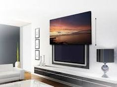 20 Attractive Home Decorating Ideas to Hide Living Room TV how to hide tv, ideas for modern living room decorating Tv Escondida, Tv Over Fireplace, Hidden Tv, Hidden Storage, Muebles Living, Tv Decor, Home Decor, Living Room Tv, Beautiful Living Rooms