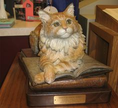 The World's Most Famous Library Cat -- Where Dewey once sat eagerly by the door, a bronze statue bearing his semblance greets visitors. Every once in a while, fans will still come by to give him a pat on the head.