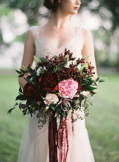 Dramatic bridal bouquet with Hanging Amaranthus, pink Garden Roses, and deep red Peonies