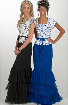 Eternity Gowns MS116  Two-piece gown with a heavily embroidered matte satin top and a ribbon tie at the waist. The Chiffon skirt has three wide ruffles at the bottom