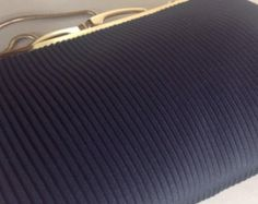 A gold and black vintage evening bag from the 60s in very good condition. Measuring approx 10x22cm. With a a gold coloured chain and frame and a clean white plastic lining this is a wonderful original evening accessory waiting to be used once again.