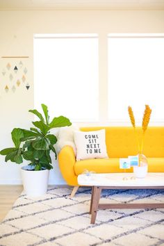 Home decor with yellow couch. Redecorating for summer. #summer #decor #home #interiordecorating