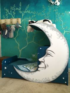 The finished product! I handmade and painted this moon bed for my toddler boys…