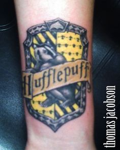 hufflepuff tattoo, I would get a slytherin one because that's what I was sorted to!!
