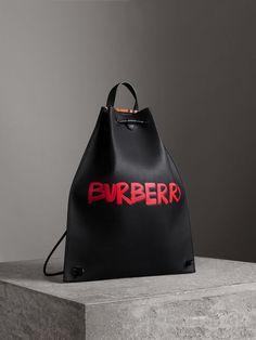 Burberry Graffiti Print Bonded Leather Drawcord Backpack In Blue Bonded Leather, Smooth Leather, Men's Leather, Burberry Handbags, Burberry Bags, Bowling Bags, Black Cross Body Bag, My Bags, Fashion Bags