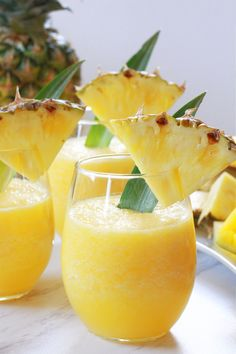 These Tropical Wine Slushies are refreshing and delicious making them the perfect summer cocktail recipe! Wine Slushie Recipe, Wine Slushies, Cocktail Recipes, Drink Recipes, Single Serving Recipes, Fruit Infused Water, Summer Cocktails, International Recipes, Yummy Drinks