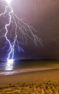 Lightning striking the sea. I used to watch nightly thunderstorms over the Atlantic when I lived at Cape May. lightning storms, lightning and thunderstorms. All Nature, Science And Nature, Amazing Nature, Spring Nature, Beautiful Sky, Beautiful World, Beautiful Places, Thunder And Lightning, Lightning Storms