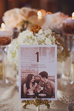 Personalize your table numbers with a photo of you and the groom at each table. Amp up the personalization even more by corresponding the number with a fun fact about the two of you.Related: 50 Memorable Ideas for Your Table Numbers